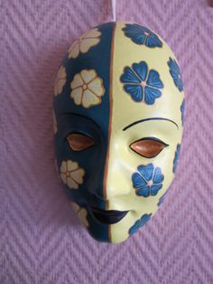 Hand-painted plaster mask, ideal for use as wall decoration. This type of mask is solid plaster so it is slightly heavy. Weight ca. 850g,