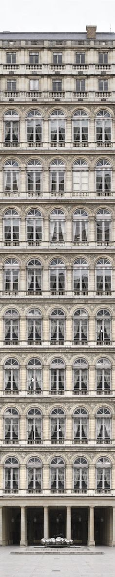 This building demonstrates rhythm because it is composed of similar textures, shapes, and form throughout. These repeated elements give the building a distinct look which is interesting to look at