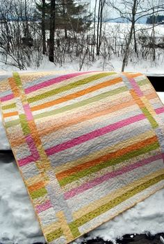 Jelly roll quilt - simple quilt.  Made with Sunkissed by Sweetwater.