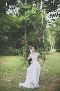 Romantic engagement shot with a handmade swing covered in flowers | Reservoir Romance: A Forested Styled Shoot - Part 1
