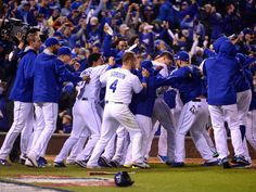 Kansas City Royals first baseman Eric Hosmer (middle) is congratulated by teammates after driving in the winning run with a sacrifice fly against the New York Mets in the 14th inning in game one of the 2015 World Series at Kauffman Stadium.  Jeff Curry, USA TODAY Sports