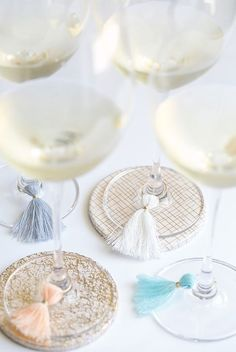 Adoring these DIY tassel wine glass charms.