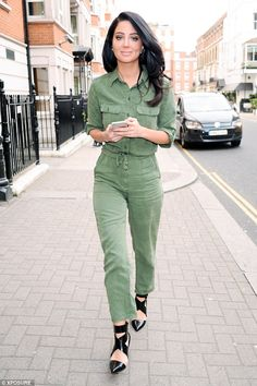 Hard at work: Tulisa Contostavlos was seen leaving record company Warner Music's headquarters in the affluent West London area of Kensington on Friday