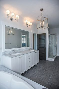 Perfect White Ensuite, Grey Marble Bath Surround And Countertops, Double Vanity,  Polished Nickel Fixtures