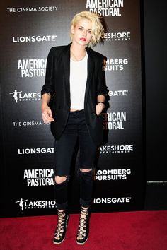 Kristen Stewart in a Sandro jacket, Alo Yoga top, Mother jeans, and Rodarte shoes.