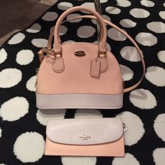 NWT peach coral coach crossbody bag  and wallet Gorgeous color mini domed satchel crossbody bag with matching wallet from Coach. The color is a nice light pink peach color. Beautiful and never used! Coach Bags Crossbody Bags