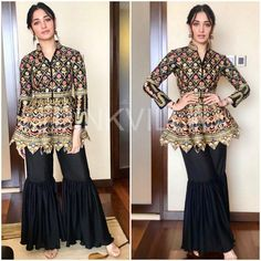 Tamannaah attended an event yesterday to promote her upcoming film 'Sketch' in Cochin. She wore a black embroidered peplum jacket that she paired wit. Pakistani Frocks, Simple Pakistani Dresses, Indian Dresses, Indian Outfits, Indian Wedding Gowns, Pakistani Wedding Outfits, All Black Dresses, Casual Dresses, Indian Designer Outfits