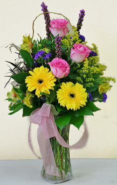 Spring flowers in yellow pink and purple. Flowers by Willow Branch Florist of Riverside Valentine Flower Arrangements, Large Flower Arrangements, Valentines Flowers, Flower Vases, Flowers In A Vase, Purple Flowers, Valentine Nails, Valentine Ideas, Special Flowers