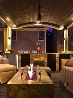 ~ A cozy and contemporary rooftop deck and bar features a fire pit and vaulted ceiling ~