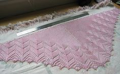 My first knitted lace shawl being blocked.