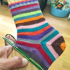 Smooth Operator Socks by Susan B. Anderson. A simple sock, no gap construction. Great for self striping yarns and variegated yarns.