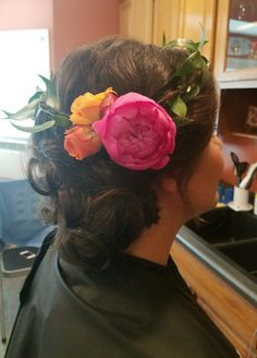 Whimsical chignon with flower crown for the bridesmaid. By Shana Montgomery owner of Fringe Theory Salon.