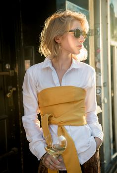 Street style outfit inspiration: what to wear with strapless tops from @stylecaster | 'Couture Kulten' blogger in marigold tie top over white button-down