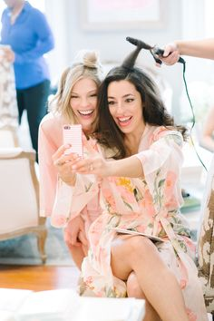 Bride and Maid of honor getting ready! Love this picture of the girls taking a selfie!  Coordination | Mac & B Events >> Photography | Aaron and Jillian Photography >> Hair/Makeup | Charleston Events Hair and Makeup
