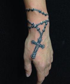 Grey rosary tattoo