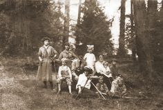 Camping, circa 1915. White dress and a big bow -- that's Doris, leaning on Daddy.