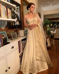 Dia Mirza at Ambani wedding. She wore Embedded balis with green stones and white motis and also with jadau gold ring from Tyaani by Karan Johar. Indian Bridal Outfits, Indian Fashion Dresses, Dress Indian Style, Indian Designer Outfits, Indian Designers, Indian Lehenga, Indian Gowns, Lehenga Choli, Dia Mirza