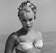 Elke Sommer  circa 1965: Portrait of German-born actor Elke Sommer posing on a beach after taking a swim, 1960s. She is wearing a bikini and a rose-petal bathing cap. (Photo by Hulton Archive/Getty Images)