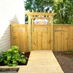 A beautiful fence and gate with an arbor