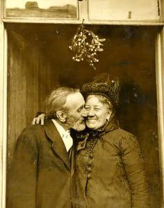 Cute elderly couple under the mistletoe.
