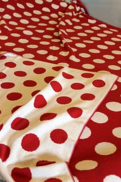 red and white polka dot throw