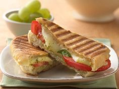 Pesto, Mozzarella and Tomato Panini. Dinner ready in 20 minutes! Enjoy classic grilled tomato and cheese sandwich with an Italian twist - a yummy meal. Sandwiches, Pesto, Vegetarian Recipes, Cooking Recipes, Easy Cooking, Cooking Ideas, Good Food, Yummy Food, Snacks