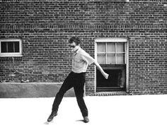 Bob Dylan cracking his bullwhip, Rhode Island 1963. Photo by David Gahr.