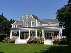 Love the wraparound porch on this classic Nantucket house.