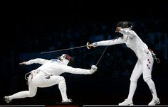 Germany's Britta Heidemann (L) competes against South Korea's Shin A Lam during their women's epee individual semifinal fencing competition at the ExCel venue at the London 2012 Olympic Games July 30, 2012. REUTERS/Damir Sagolj (BRITAIN - Tags: SPORT OLYMPICS SPORT FENCING)
