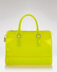 """Furla Satchel - Candy  PRICE: $228.00  Furla comes ready to play with this rubber satchel. The shape is sophisticated, while the citrus hue is in perfect step with this season's move toward bold accessorizing.        Rubber      Imported      Double top handles      Top zip closure      11.75""""W x 7.5""""H x 6.75"""", 6"""" handle drop      Web ID: 591631"""