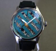Hazard Skeletonized Wristwatch in Stainless Steel with niobium dial. $500.00, via Etsy.