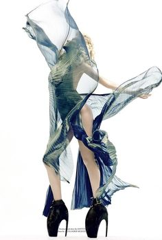 Alyona Osmanova, 2010, Gottex sunray pleat gown and Alexander McQueen's sci-fi monster heels