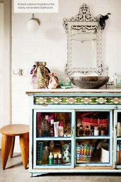 Vintage painted cabinet used as a bathroom vanity