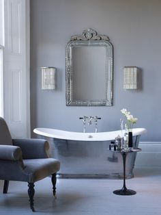 Polished bain de bateau with mirror above and armchair