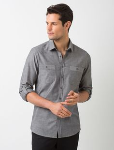 The Men's Rex Utility Shirt in Charcoal is as stylish as it is versatile, delivering a premium look for your crew. The Rex in Charcoal compliments different uniform styles and work environments from casual hospitality uniforms to modern corporate wear. The 100% cotton chambray fabric has a slight texture adding a premium finish, and is detailed with utility style pockets on the chest and optional roll up sleeves. Also Available in Olive and in a women's cut. Shown here with: Men's Todd…