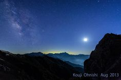 Timeless, In the moonlight  I imagine the distant universe. Our star floating in space to spread.  And they gather, group of giant stars, Galaxy is made of.  I imagine the Galaxy far,  receiving moonlight now at the top of a mountain.  Now, I am under this starlit sky.      月明かりの中で  遥か遠い宇宙を想像する。 広がる空間に浮かぶ星々  それらが集まり、巨大な星の集団、 銀河ができている。   いま、山の頂で月明かりを 受けながら、私は遥か銀河を想像する。 いま、私はこの星空の下にいる。
