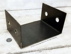 This page features custom timber post brackets used on the tops and the bottoms of wooden posts. From basic post bases, uplift post brackets, caps that con. Timber Posts, Wooden Posts, Metal Beam, Wood And Metal, Beam Hangers, Building Products, Ranch Style Homes, Iron Work, Metal Accents