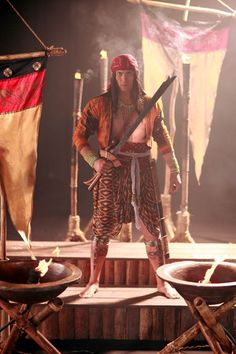 From Amaya: warrior with kampilan. Kampilan were sometimes forged long enough to be used two-handed.