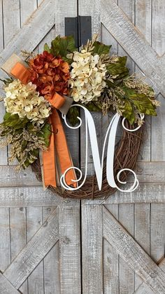 Make your home more inviting with this gorgeous wreath filled with a trio of lush, faux hydrangeas, heather and stems of twigs and foliage.  This would be perfect to welcome guests on your front door, place over your mantel or add the perfect touch to your walls.    A combination of two gorgeous creamy hydrangeas and one variegated rust/orange hydrangea are arranged together for a warm inviting mix of color. Outside Fall Decorations, Country Christmas Decorations, Thanksgiving Decorations, Primitive Fall Decorating, Autumn Decorating, Diy Fall Wreath, Autumn Wreaths, Initial Wreath, Door Monogram