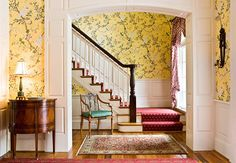 A runner in red and gold ties the hallway's sunny palette together. Do you like it?