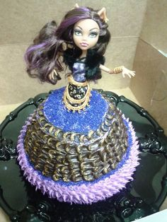 Monster High birthday cake. Perfect for Halloween party too! Clawdeen Wolf on top of a cake baked in the Pampered Chef classic batter bowl stacked on two 9-inch rounds
