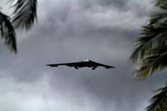 A B-2 Spirit strategic bomber conducts a low approach training flight over Hickam Air Force Base, Hawaii April 2, 2014. Two B-52 Stratofortress strategic bombers from Barksdale Air Force Base, La. and two B-2 Spirit strategic bombers from Whiteman Air Force Base, Mo., flew non-stop from their respective home stations to training ranges within the vicinity of Hawaii and conducted range training operations and low approach training flights at Hickam AFB.(USMC Lance Cpl.Wesley Timm)