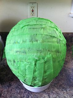 Base for round piñata for TMNT Teenage Mutant Ninja Turtle birthday party Step 3: Cover with layer of crepe paper
