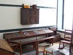 school room, pleasant hill shaker village. Long study table with tilted top. Simple bench. Little detail.
