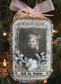 vintage Christmas tin.... you can make vintage ornaments with photos of loved ones. If they are color copy them in Black and white to have them all look great. A wonderful way to remember our loved ones at Christmas time.