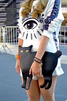 walkthatstreet:  wgsn:  Cat bag! #NYFW #streetstyle  WGSN street shot, New York Fashion Week, spring/summer 2014  Message me if you're a street style blog! - here, need more blogs to follow