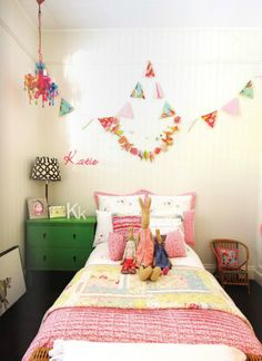 girl's rooms - ivory beadboard walls twin bed yellow pink bedding kelly green chest nightstand colorful glass chandelier  Sweet girl's bedroom