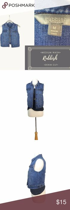 """Medium Wash Denim Vest Cut by Rubbish Size Med This cute denim vest by Rubbish is sold at Nordstrom. It features a nice medium denim wash with antique bronze colored buttons. The denim is in great shape and is perfect for layering with dresses, flowy tops or skinny colored jeans. 95% cotton, 5% spandex  Measurements are taken laying flat: Shoulders: 13.5"""" Bust: 16.5"""" Waist: 16"""" Length: 19""""  Feel free to ask any questions!  D20 Rubbish Jackets & Coats Vests"""