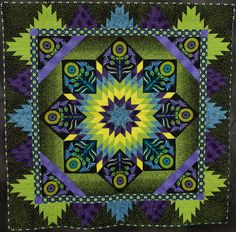 Made by Mary Kay Davis  Quilted by Mary Kay Davis  Started in 2010, Finished in 2010  Design basis: Original Design  Artist statement: I made this quilt for the McCall's Quilt Design Star Contest 2010. You could only use two blocks. I used Delectable Mountains and Lone Star. I had to depend on my fabric choices to complete the design.    http://www.road2ca.com/2012winners/images/front/10290.jpg
