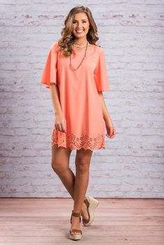 """""""Cut Out From The Same Cloth Dress, Peach""""It is almost crucial that you get one of these peach beauties before they all sell out! The simple style is not only a breeze to wear, but perfect for any occasion this season! #newarrivals #shopthemint"""